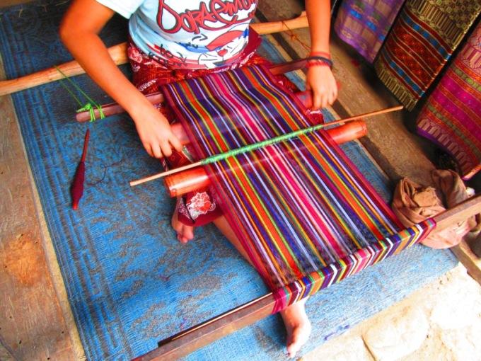 A girl weave the yarn..